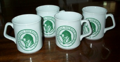 Four earthenware mugs